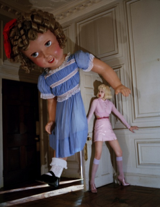 Woman hiding from giant doll - Tim Walker photo